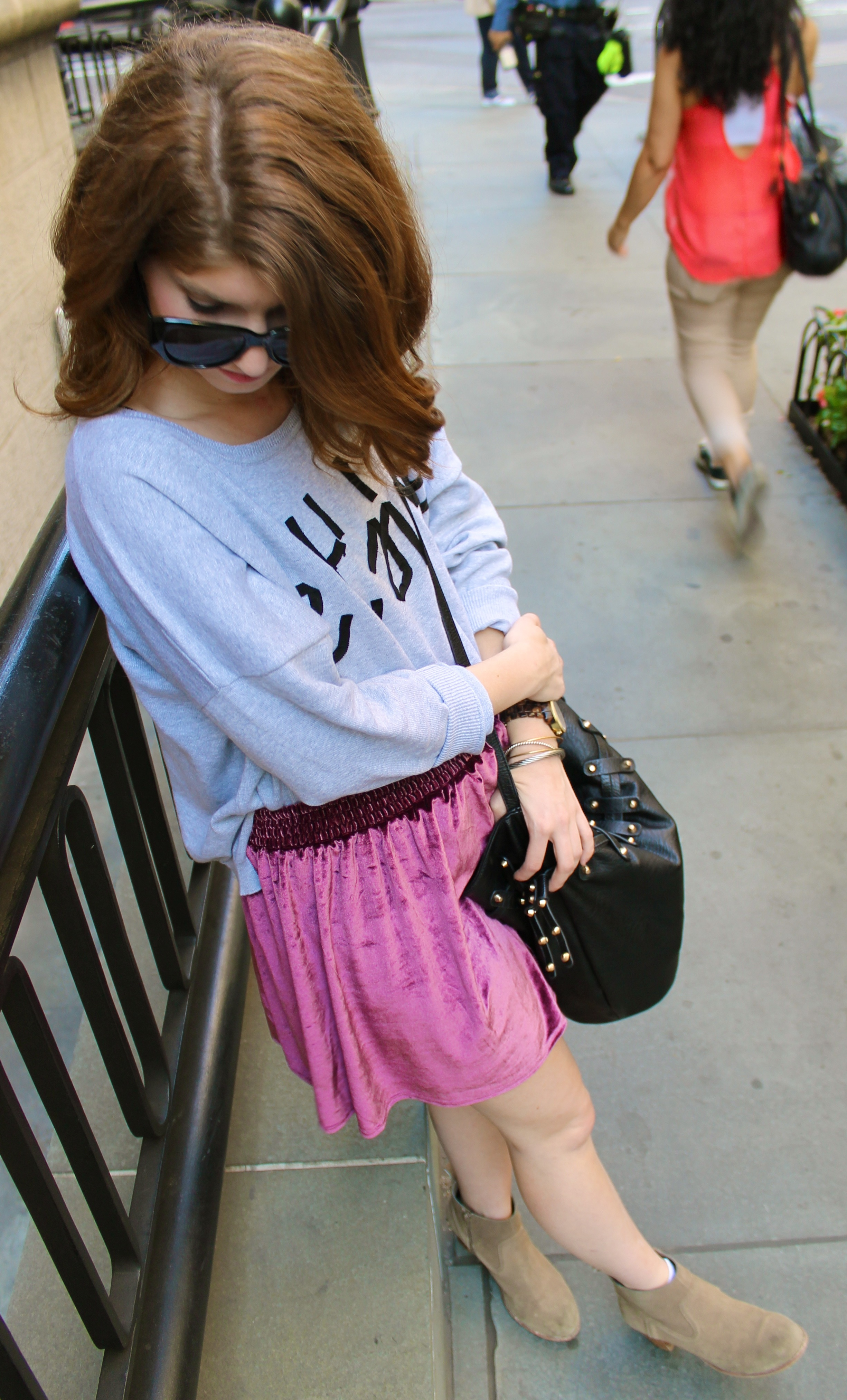 gray sweater and velvet skirt