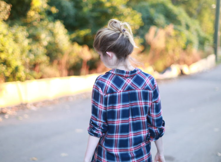 plaid shirt and white jeans